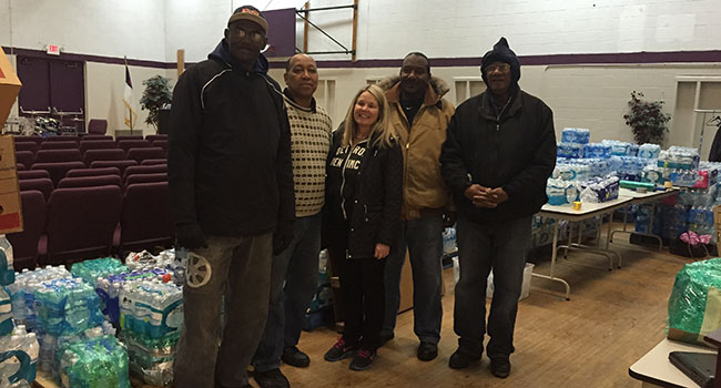 At the Calvary Community Church, volunteers assist with the collection and distribution of bottled water in the wake of Flint's lead water crisis.