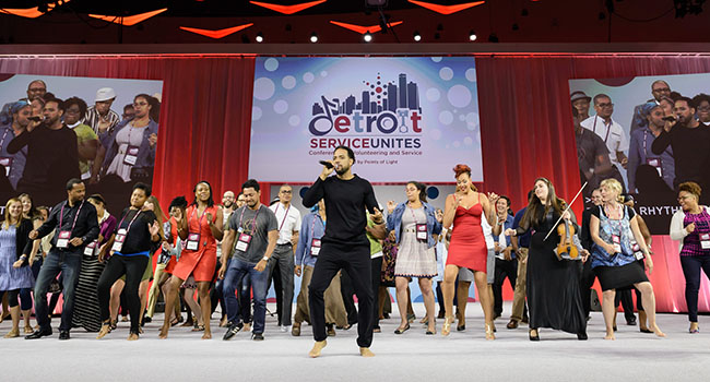 """As changemakers, we have been charged to live our passion out loud, with enthusiasm,"" said emcee Mike Ellison, who invited attendees on stage to participate in his final performance at Conference."