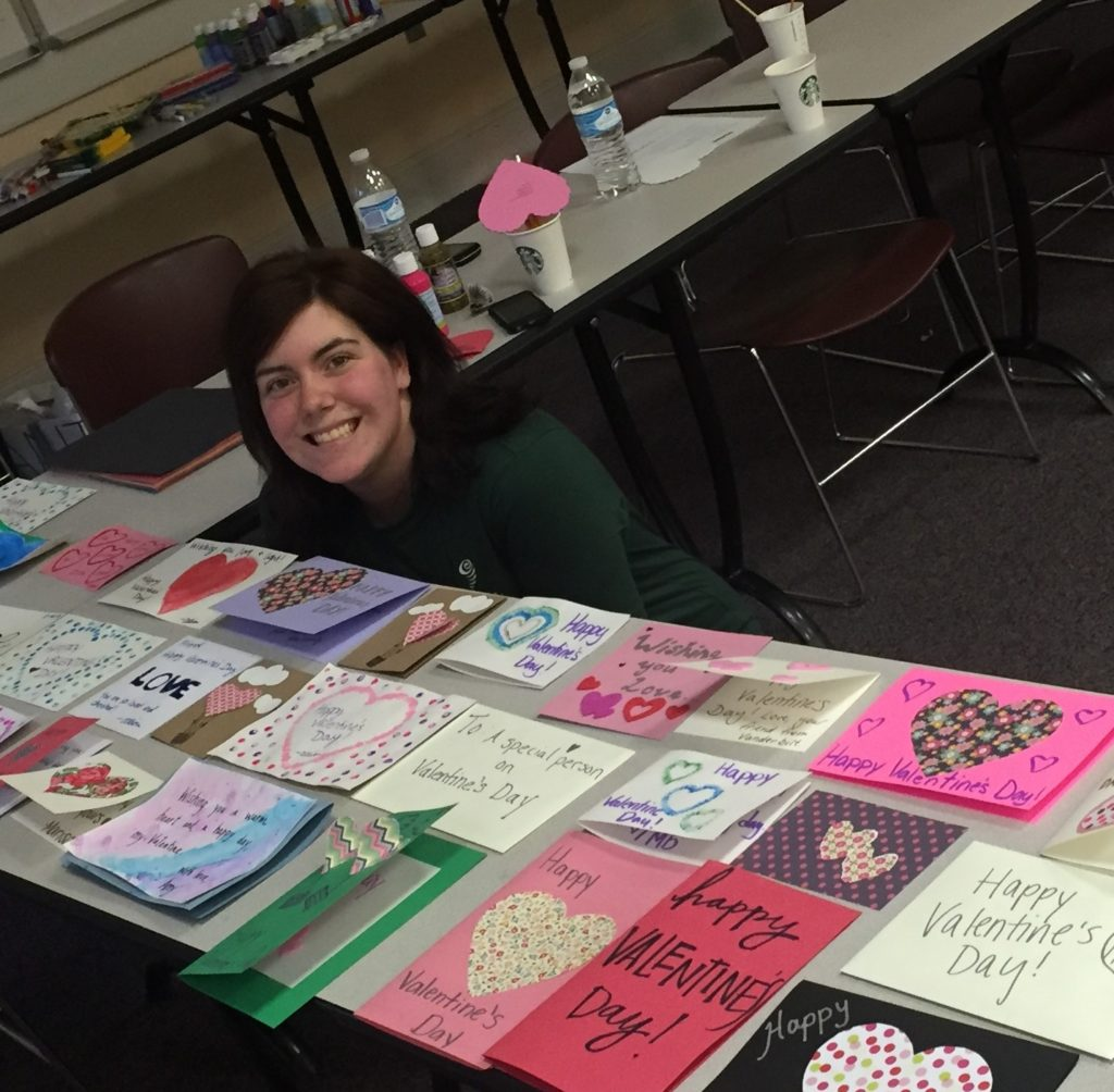Allison Plattsmier pictured with Valentine's Day cards she helped create for Meals on Wheels recipients.