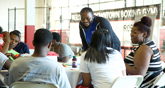 Alonzo Warren works with Service Scholars at a ServiceWorks Bootcamp in Detroit.