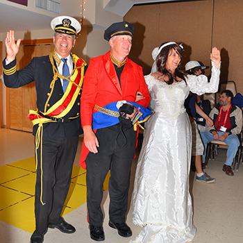 Andy Cesnickas (center) dressed as a naval officer to amuse camp attendees.