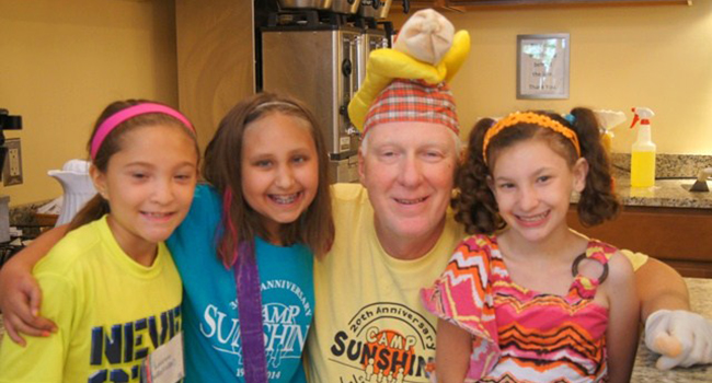 Andy Cesnickas with campers at Camp Sunshine, which provides weeklong retreats for children with terminal or life-threatening illnesses.