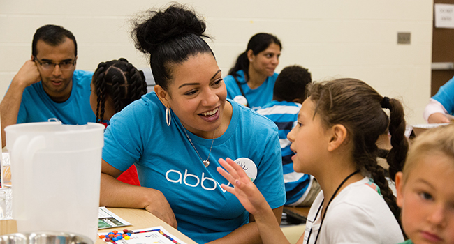 AbbVie employees lead a group of summer school students through Science Adventures, an interactive day of hands-on science activities in North Chicago, Ill.