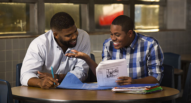 AT&T employee Rob Weaver mentors a student as part of the company's AT&T Aspire program.