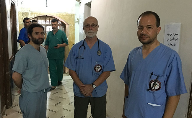 Samer Attar, John Kahler and Zaher Sahloul at a hospital visiting a fellow doctor who had been killed in a Russian airstrike.