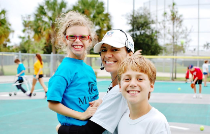 Miracle League player Hailey (left) pictured with Julia Kadel and Jackson Kadel, Hailey's able-bodied buddy./Courtesy of Julia Kadel