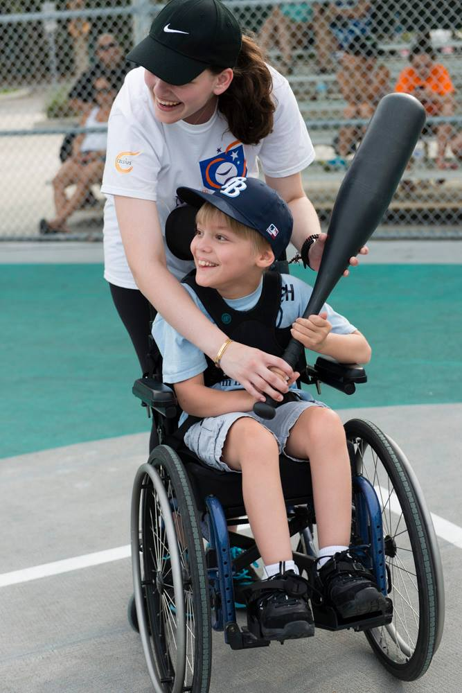 Volunteer Ava Goldstone and Miracle League player Josh./Courtesy Julia Kadel