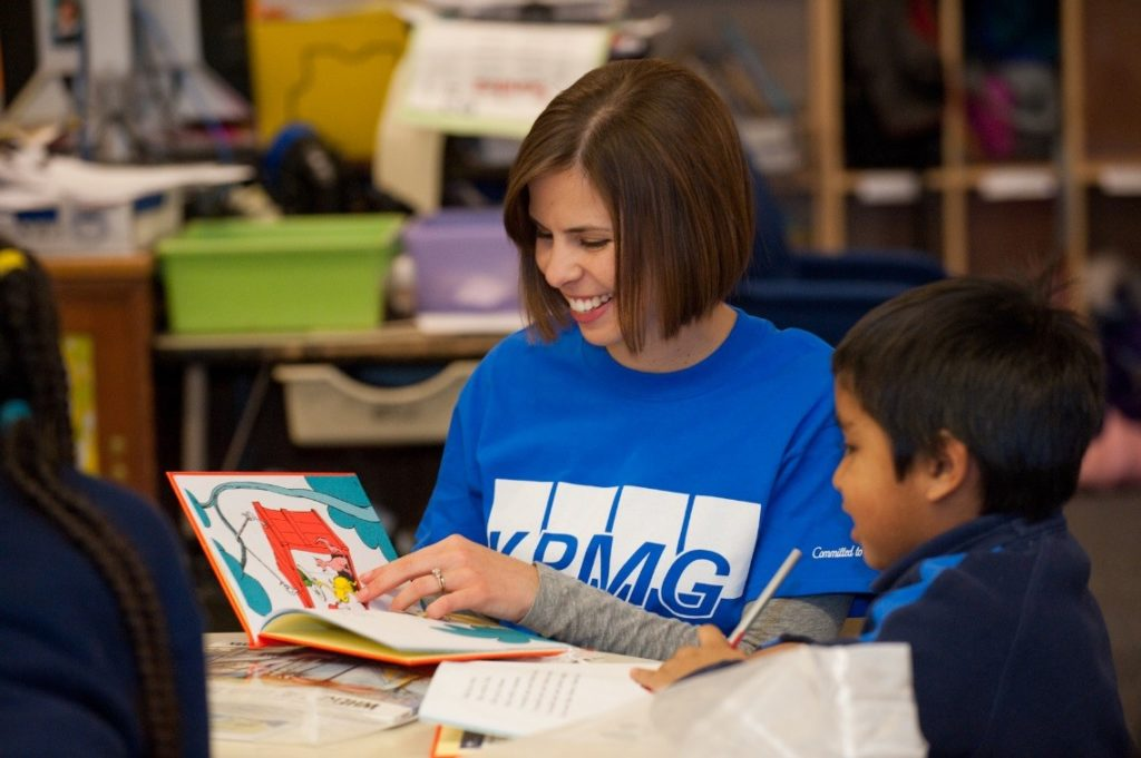 KPMG's Family for Literacy program gives new books to children in need.