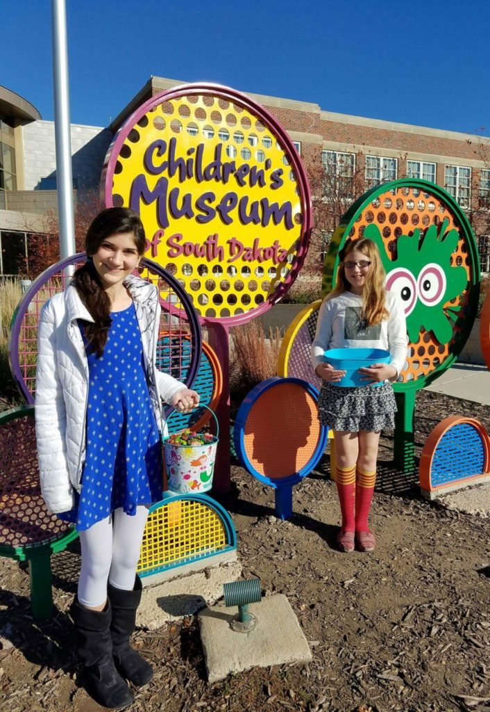 Abby and Riley collect crayons from the Children's Museum of South Dakota.