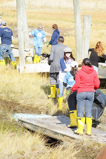 Volunteers participate in clean-up projects on Long Island after Superstorm Sandy.