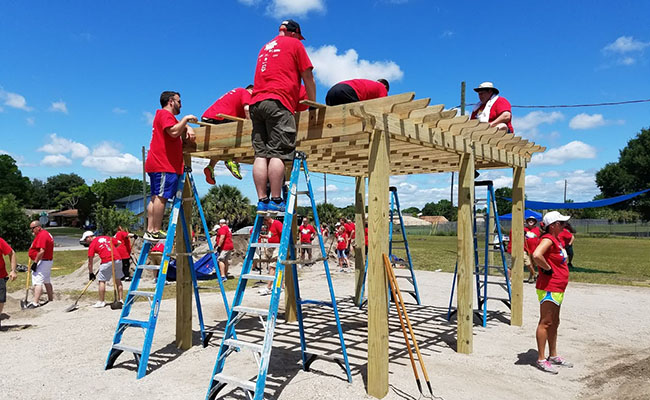 Hands On Orlando volunteers work together to build a structure at a local park.