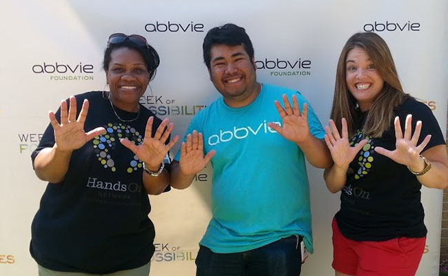 "Jen Nash (left) and Kate Nichols (right) of Points of Light, with AbbVie intern Alex Porcayo at an AbbVie ""Week of Possibilities"" event."