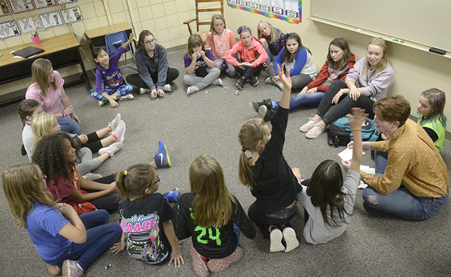 Volunteer student leaders engage Like A Girl participants in an empowerment icebreaker at Fredstrom Elementary School.