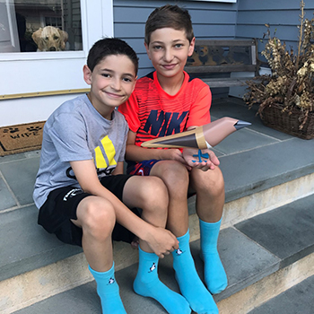 Matty and Will Gladstone, wearing the Blue Feet Foundation's signature blue socks.