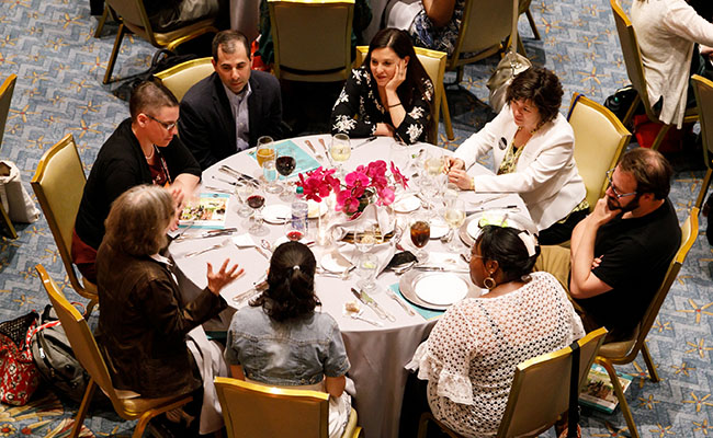 Attendees participate in a table discussion at the Service Supper, co-hosted by Points of Light and Repair the World.
