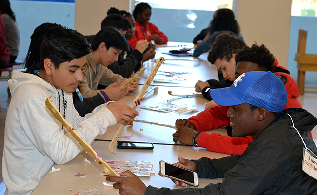 Teens participate in a service project at the 2017 Be The Change Youth Summit.