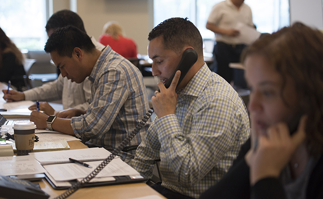 Employee volunteers from CSAA Insurance Group make wellness calls to community members affected by the California wildfires.