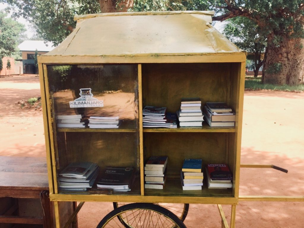 A mobile library that brings books to local schools in Moshi, Tanzania. The idea was conceived by a young woman who took part in Mahika's program./Courtesy Mahika Halepete