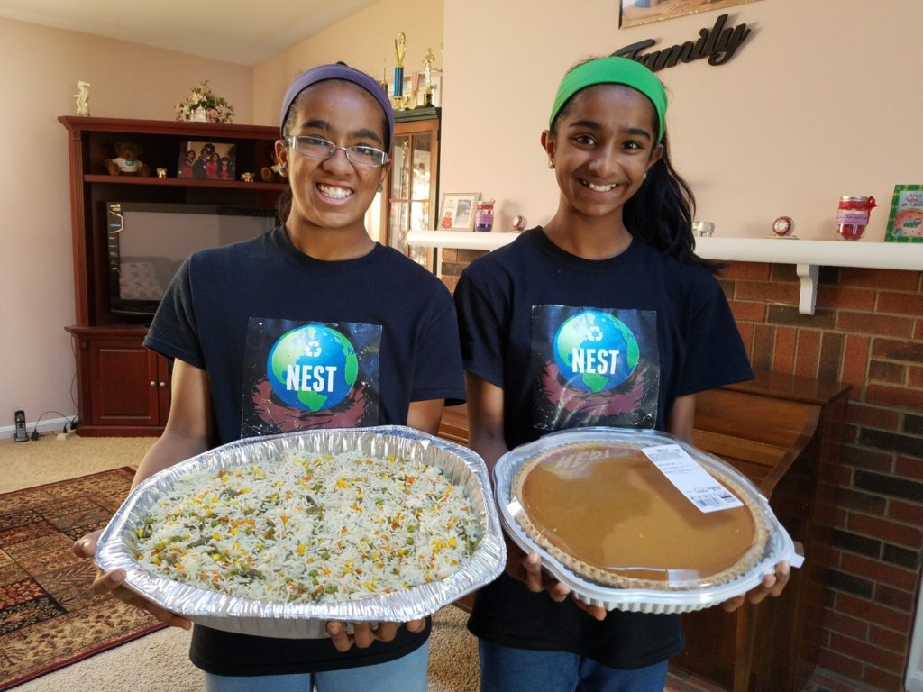 Shreyaa (left) and Esha (right) excited and ready to serve Thanksgiving Feast to the homeless community in Washington D.C./ Courtesy Shreyaa & Esha Venkat