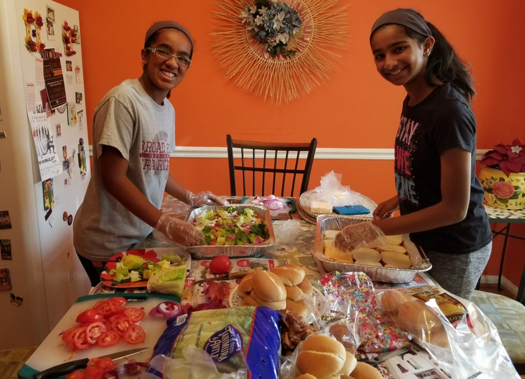 Shreyaa (left) and Esha (right) making burgers for the homeless at the Loudoun Homeless Services Center, Leesburg VA./ Courtesy Shreyaa & Esha Venkat