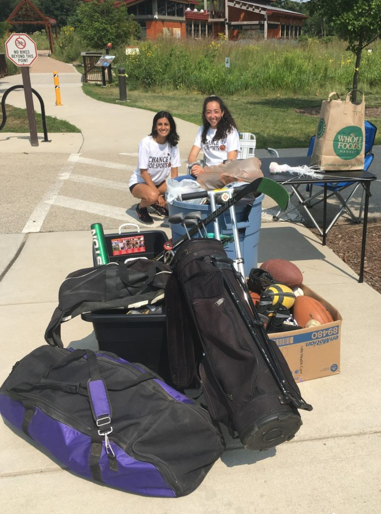 Anuva pictured with her board member, Tala Fahoum, alongside sports equipment donations received during a 2018 summer fundraiser./ Courtesy Anuva Shandilya