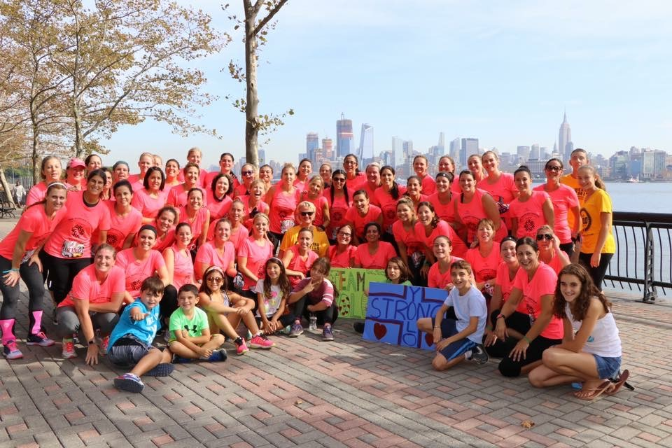 Danielle Taylor has persuaded more than 200 women to undertake strenuous obstacle course races to raise money for children in need.  This group poses in New Jersey in 2017 against the New York City skyline./ Courtesy Danielle Taylor