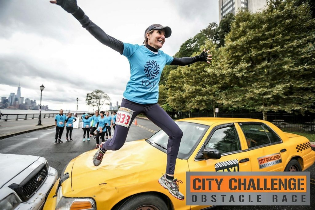 Danielle Taylor jumps over a taxi as part of the City Challenge obstacle course race for charity in Hoboken, N.J., in October 2018./Courtesy Danielle Taylor