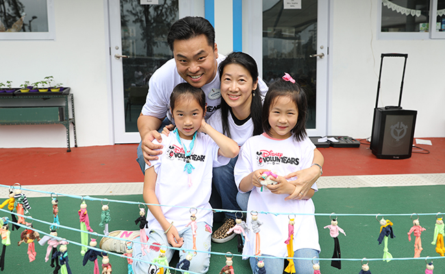 A family of four participates in HandsOn Hong Kong's 2018 Family Volunteer Day project, upcycling unwanted materials into donated items for community centers.