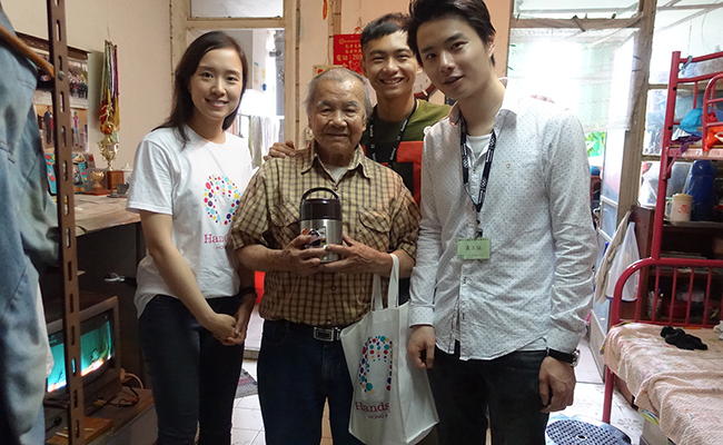 HandsOn Hong Kong volunteers spend time with seniors and deliver homemade soup through the Soup for the Elderly program..