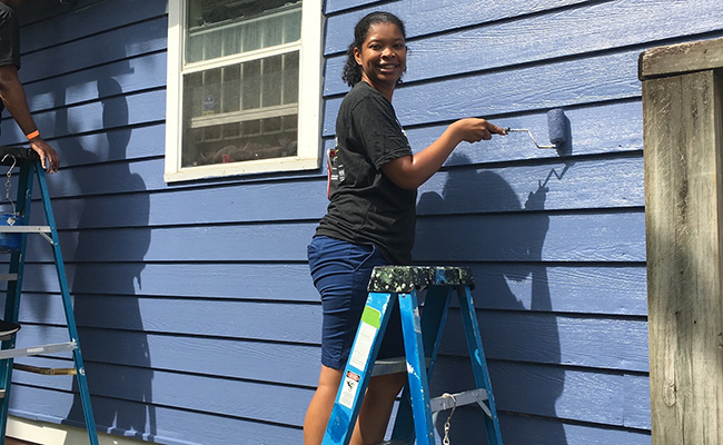 Martina Edwards participates in a home painting project with Westside Volunteer Corp in Atlanta.