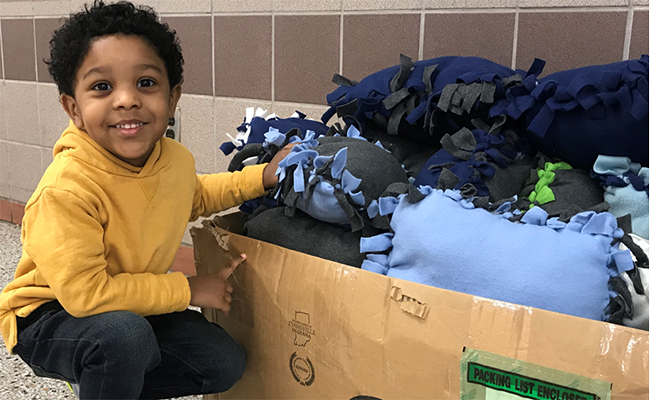Jersey Cares youth volunteer creates comfort kits for children in need.