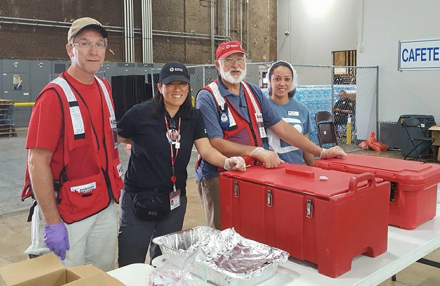 Vivian Moy pictured alongside the Red Cross feeding crew inside of a mega shelter in San Antonio, Texas during Hurricane Harvey.  The team served hot meals to those displaced as a result of the hurricane./Courtesy Vivian Moy