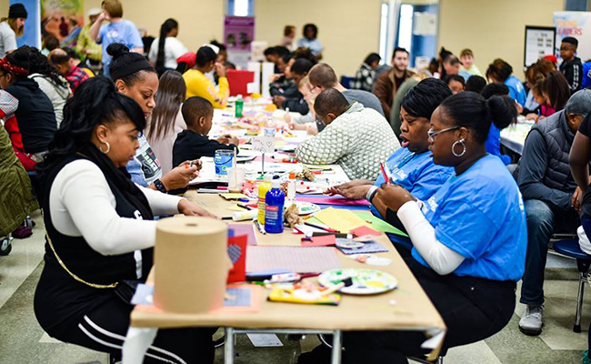 Volunteers create cards of encouragement with United Way of Central Carolinas.
