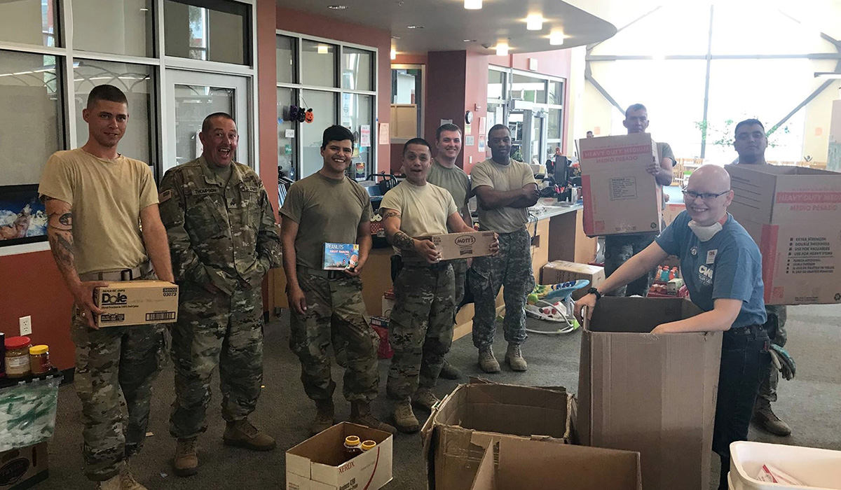 National Guard members from Travis Air Force Base visit the American Canyon shelter to help sort donations.