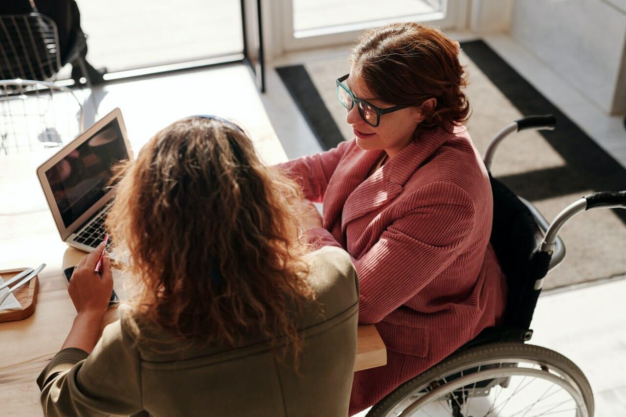 Volunteer in wheel chair helps organization deliver on programs.
