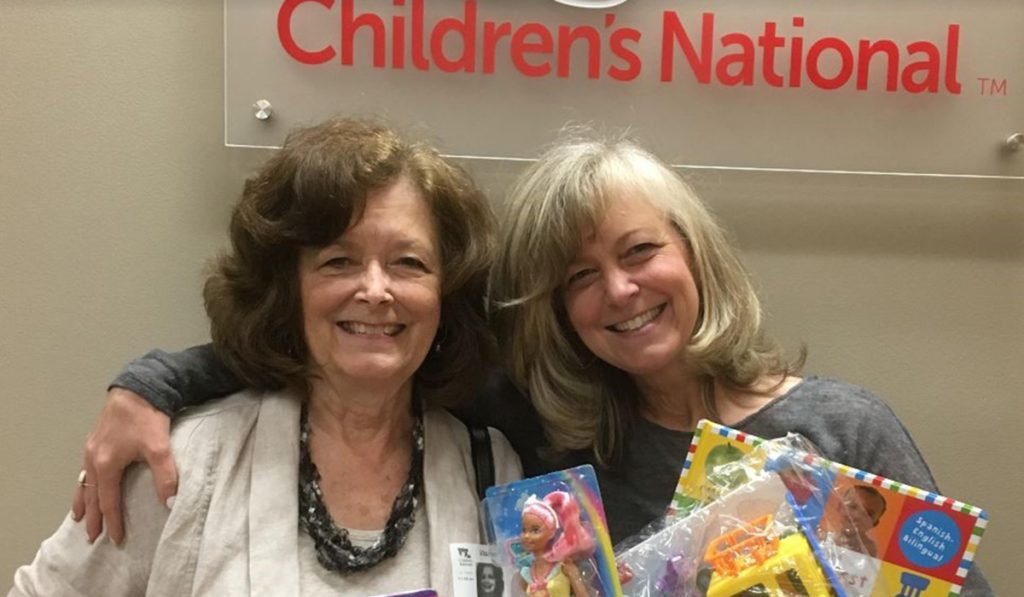 Daily Point of Light Award Honoree Kristen Weinberg, right, and her mother deliver toy's to a children's hospital in Washington, D.C. as part of her What's Your 50? movement.